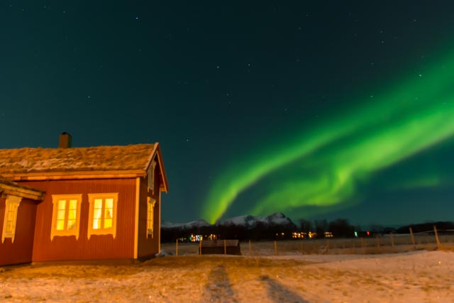 Northern Light above the Red house by Marco Stalder